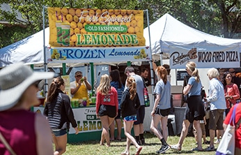 Visitors line up for old fashioned lemonade and wood fired pizza