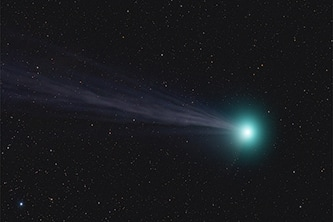 An photograph of a comet surrounded by stars by an anonymous member of the group
